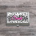 Black sparkles on white business card holder with magenta colored name