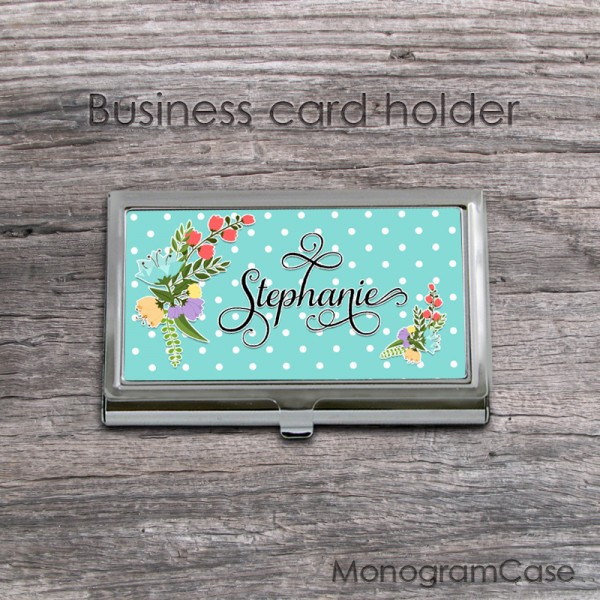 Polka dots background card holder case with spring flowers