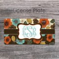 Stylish blue orange brown floral pattern monogrammed license plate