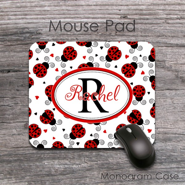 Fancy letters with ladybugs on a computer mouse pad