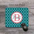 Teal lattice pattern on coral monogram mouse pad