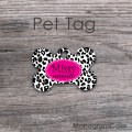 Black and white cheetah bone dog ID tag